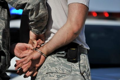 Kratom legality in Alabama can lead to arrests like the man in handcuffs pictured here