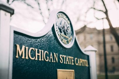 Michigan Kratom Vendors and Michigan State Capitol sign