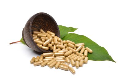 Kratom capsules and leaves